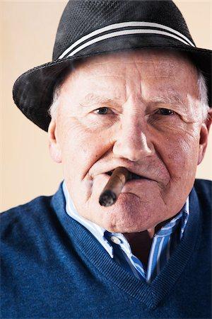 Portrait of Senior Man Smoking Cigar Stock Photo - Premium Royalty-Free, Code: 600-06382927