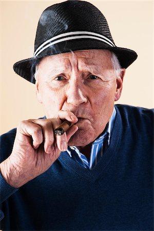 Portrait of Senior Man Smoking Cigar Stock Photo - Premium Royalty-Free, Code: 600-06382928