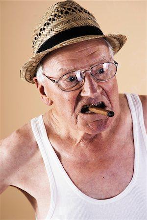 Portrait of Senior Man Smoking Cigar Stock Photo - Premium Royalty-Free, Code: 600-06382933