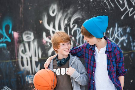 Boys with Basketball by Graffiti Covered Wall, Mannheim, Baden-Wurttemberg, Germany Stock Photo - Premium Royalty-Free, Code: 600-06397444