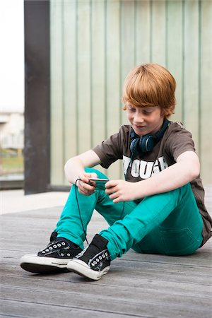 funky - Boy with MP3 Player Outdoors, Mannheim, Baden-Wurttemberg, Germany Stock Photo - Premium Royalty-Free, Code: 600-06397447