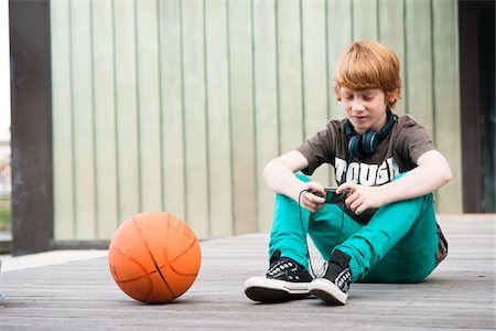 funky - Boy with MP3 Player Outdoors, Mannheim, Baden-Wurttemberg, Germany Stock Photo - Premium Royalty-Free, Code: 600-06397448