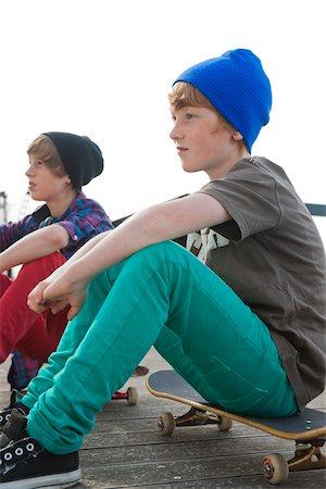 Boys Sitting on Skateboards, Mannheim, Baden-Wurttemberg, Germany Stock Photo - Premium Royalty-Free, Code: 600-06397451