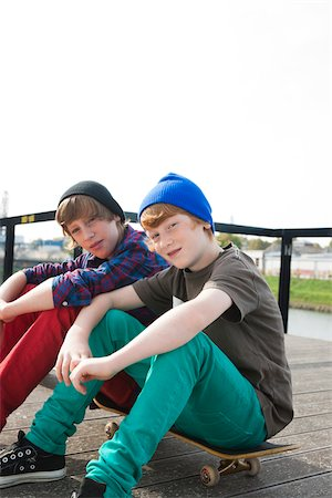 funky - Boys Sitting on Skateboards, Mannheim, Baden-Wurttemberg, Germany Stock Photo - Premium Royalty-Free, Code: 600-06397452