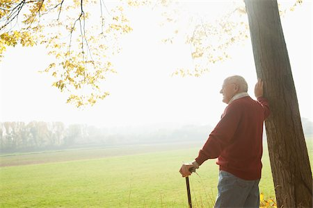 Senior Man with Cane Standing by Tree, Lampertheim, Hesse, Germany Stock Photo - Premium Royalty-Free, Code: 600-06397466
