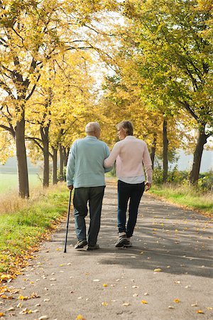Mature Woman Walking with Senior Father in Autumn, Lampertheim, Hesse, Germany Stock Photo - Premium Royalty-Free, Code: 600-06397468
