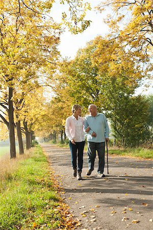 senior lady walking - Mature Woman Walking with Senior Father in Autumn, Lampertheim, Hesse, Germany Stock Photo - Premium Royalty-Free, Code: 600-06397469