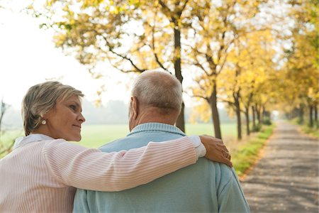 Mature Woman with Arm around Shoulder of Senior Father in Autumn, Lampertheim, Hesse, Germany Stock Photo - Premium Royalty-Free, Code: 600-06397470