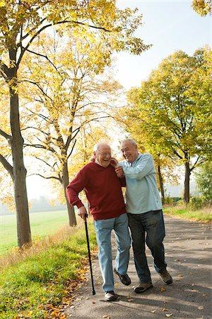 Senior Men Walking on Tree-lined Path in Autumn, Lampertheim, Hesse, Germany Stock Photo - Premium Royalty-Free, Code: 600-06397473