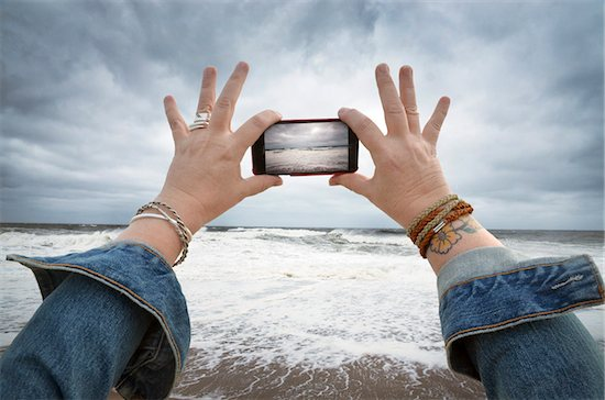 Woman Taking Photo of Impending Hurricane Sandy, Point Pleasant, New Jersey, USA Stock Photo - Premium Royalty-Free, Artist: Andrew Kolb, Image code: 600-06397741