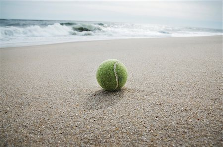 Close-up of Tennis Ball Washed up on Beach, Point Pleasant, New Jersey, USA Stock Photo - Premium Royalty-Free, Code: 600-06397742