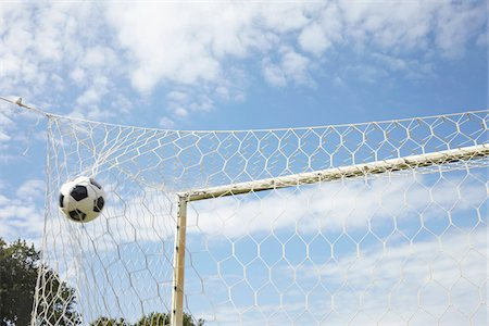 Soccer Ball in Goal, Cap Ferret, Gironde, Aquitaine, France Stock Photo - Premium Royalty-Free, Code: 600-06407725