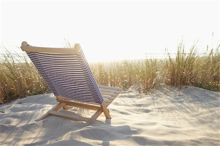 Beach Chair and Dune Grass on the Beach, Cap Ferret, Gironde, Aquitaine, France Stock Photo - Premium Royalty-Free, Code: 600-06407722