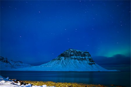 star - Mt Kirkjufell in Grundarfjordur bay, Iceland at a winter night Stock Photo - Premium Royalty-Free, Code: 600-06407895