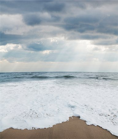 Waves at Beach with Sunrays through Clouds, Point Pleasant, New Jersey, USA Stock Photo - Premium Royalty-Free, Code: 600-06438866