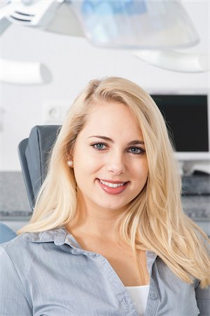 dentistry - Close-up of Young Woman at Dentist's Office for Appointment, Germany Stock Photo - Premium Royalty-Free, Code: 600-06438877
