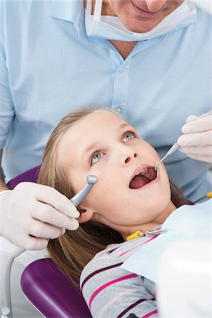 preteen open mouth - Dentist Checking Girl's Teeth at Appointment, Germany Stock Photo - Premium Royalty-Free, Code: 600-06438940