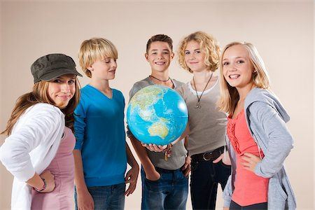 Portrait of Group of Teenage Boys and Girls Holding World Globe, Smiling and Looking at Camera, Studio Shot on White Background Stock Photo - Premium Royalty-Free, Code: 600-06438968