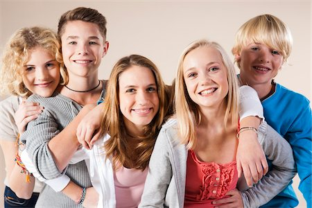 Portrait of Group of Teenage Boys and Girls Smiling at Camera, Studio Shot on White Background Stock Photo - Premium Royalty-Free, Code: 600-06438963