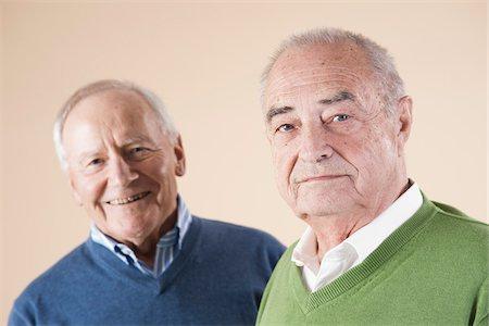Portrait of Two Senior Men Looking at Camera, Studio Shot on Beige Background Stock Photo - Premium Royalty-Free, Code: 600-06438986