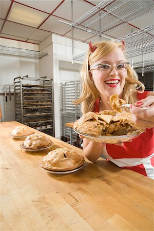 quirky - Woman Wearing Devil Horns at a Bakery, Oakland, Alameda County, California, USA Stock Photo - Premium Royalty-Free, Code: 600-06431348