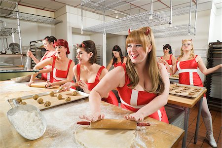 quirky - Women Wearing Devil Horns Working at a Bakery, Oakland, Alameda County, California, USA Stock Photo - Premium Royalty-Free, Code: 600-06431355