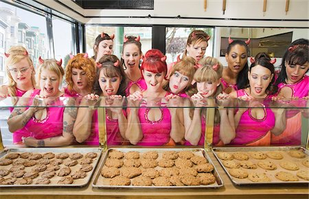 quirky - Women Wearing Devil Horns at a Bakery, Oakland, Alameda County, California, USA Stock Photo - Premium Royalty-Free, Code: 600-06431359