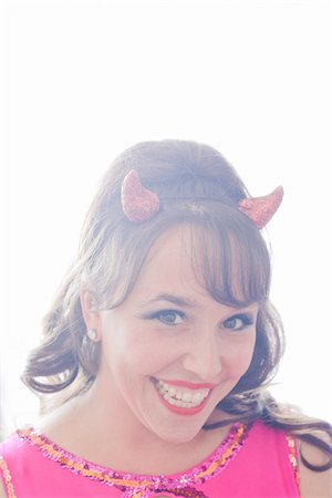 quirky - Portrait of Woman Wearing Devil Horns Stock Photo - Premium Royalty-Free, Code: 600-06431367