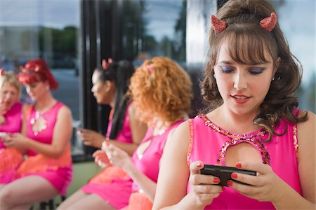 quirky - Women Wearing Devil Horns and Costumes Using Cellular Telephones, Oakland, Alameda County, California, USA Stock Photo - Premium Royalty-Free, Code: 600-06431371
