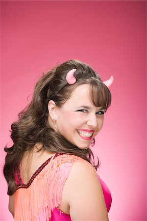 Portrait of Woman Wearing Devil Horns and Smiling Stock Photo - Premium Royalty-Free, Code: 600-06431385