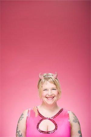 Portrait of Woman Wearing Devil Horns Stock Photo - Premium Royalty-Free, Code: 600-06431397