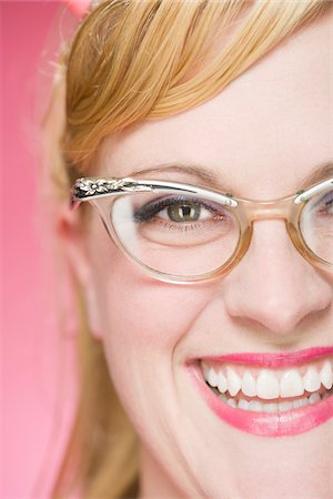 Portrait of Woman Wearing Vintage Eyeglasses Stock Photo - Premium Royalty-Free, Code: 600-06431399