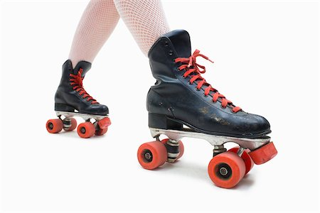 roller skate - Woman Wearing Fishnet Stockings and Old Fashioned Roller Skates Stock Photo - Premium Royalty-Free, Code: 600-06431391