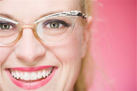 Portrait of Woman Wearing Vintage Eyeglasses Stock Photo - Premium Royalty-Free, Code: 600-06431401