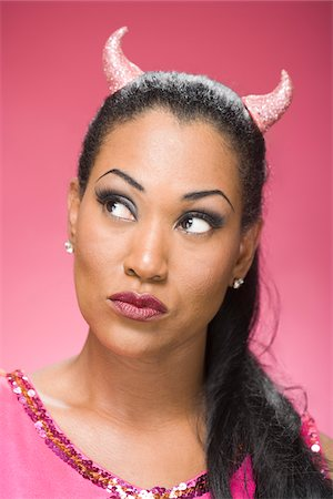quirky - Portrait of Woman Wearing Devil Horns and Thinking Stock Photo - Premium Royalty-Free, Code: 600-06431425