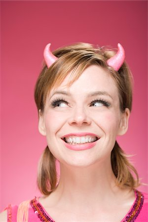 Portrait of Woman Wearing Devil Horns Stock Photo - Premium Royalty-Free, Code: 600-06431422