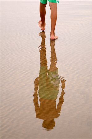 Boy's Legs Walking on Beach with Reflection, Rabat, Morocco Stock Photo - Premium Royalty-Free, Code: 600-06451969