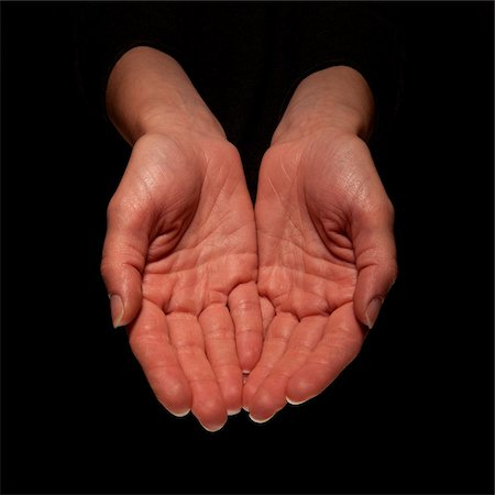 Close-up of Palms of Woman's Hands, Studio Shot Stock Photo - Premium Royalty-Free, Code: 600-06452117