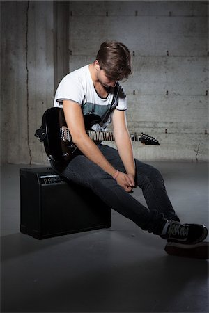 Young Man Holding Electric Guitar Stock Photo - Premium Royalty-Free, Code: 600-06465376