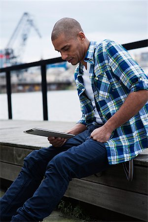Portrait of Man Using a Tablet Outdoors, Mannheim, Baden-Wurttemberg, Germany Stock Photo - Premium Royalty-Free, Code: 600-06485969
