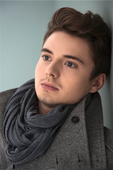 Head and Shoulder Portrait of Young Man wearing Grey Scarf and Jacket, Studio Shot on Grey Background Stock Photo - Premium Royalty-Free, Artist: Uwe Umstätter, Image code: 600-06486249