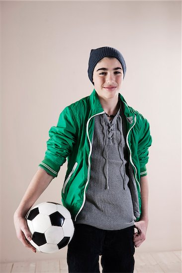 Portrait of Boy with Soccer Ball in Studio Stock Photo - Premium Royalty-Free, Artist: Uwe Umstätter, Image code: 600-06486401
