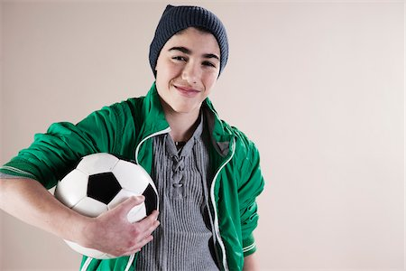 Portrait of Boy holding Soccer Ball in Studio Stock Photo - Premium Royalty-Free, Code: 600-06486403