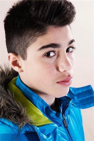 Portrait of Boy in Winter Coat in Studio Stock Photo - Premium Royalty-Free, Code: 600-06486425