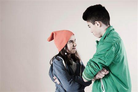 Girl and Boy Arguing in Studio Stock Photo - Premium Royalty-Free, Code: 600-06486435