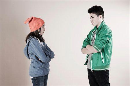 Boy and Girl Arguing in Studio Stock Photo - Premium Royalty-Free, Code: 600-06486436