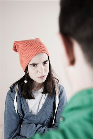 focus on background - Boy and Girl Arguing in Studio Stock Photo - Premium Royalty-Free, Code: 600-06486437