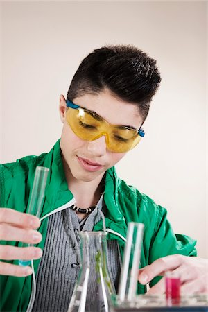 Boy wearing Safety Glasses with Test Tubes, Mannheim, Baden-Wurttemberg, Germany Stock Photo - Premium Royalty-Free, Code: 600-06486449