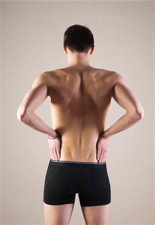 Backview of Young Man wearing Underwear with Hands on Hips, Studio Shot Stock Photo - Premium Royalty-Free, Code: 600-06505866