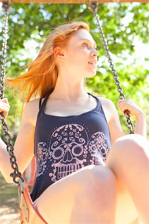 female only - Young Woman on Swing in park on a warm summer day in Portland, Oregon, USA Stock Photo - Premium Royalty-Free, Code: 600-06531464